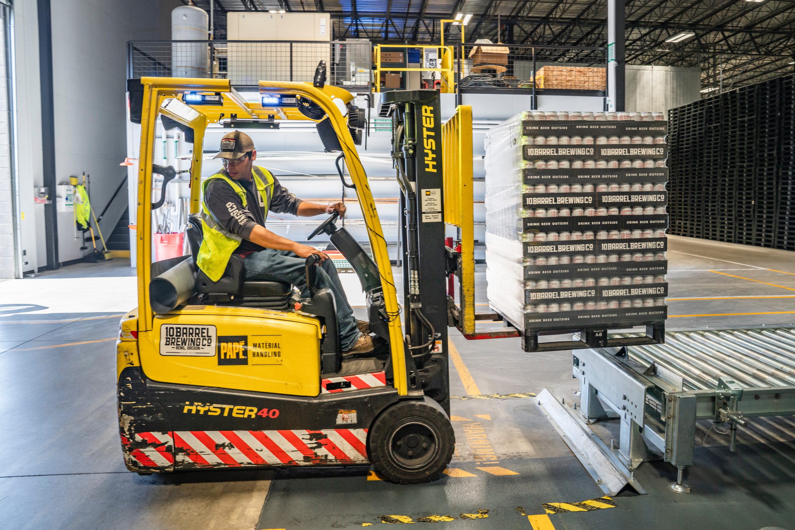 Distribution worker using a forklift in a warehouse
